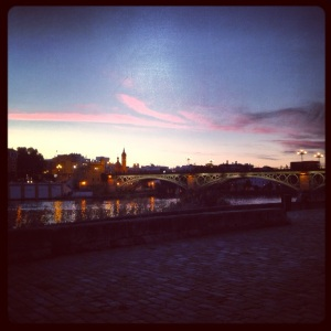 Sunset overlooking the Guadalquivir River. The Isabel Bridge leads from the Historic Center of Sevilla to Triana where our flat is.