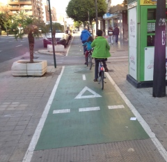 Riding in the bike lanes toward the Turia River Park from our flat.
