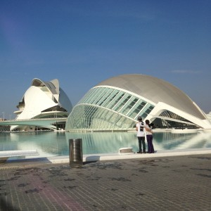 Standing amongst the Ciudad de las Artes y Ciencias. The kids are looking towards the Hemisféric and the Palau de las Artes. In the foreground is a Planetarium, and the larger one in the background is a Performing Arts Center that looks just like the Jetsons house would have if it really existed.
